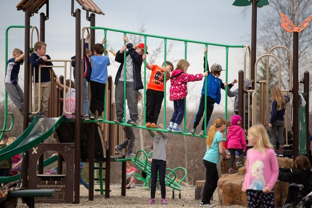 Children play on a playground at recess.
