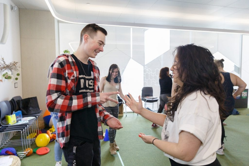 Students play a rock paper scissors game at the In Good Health YYC / Miyomahchihowin class in Calgary.