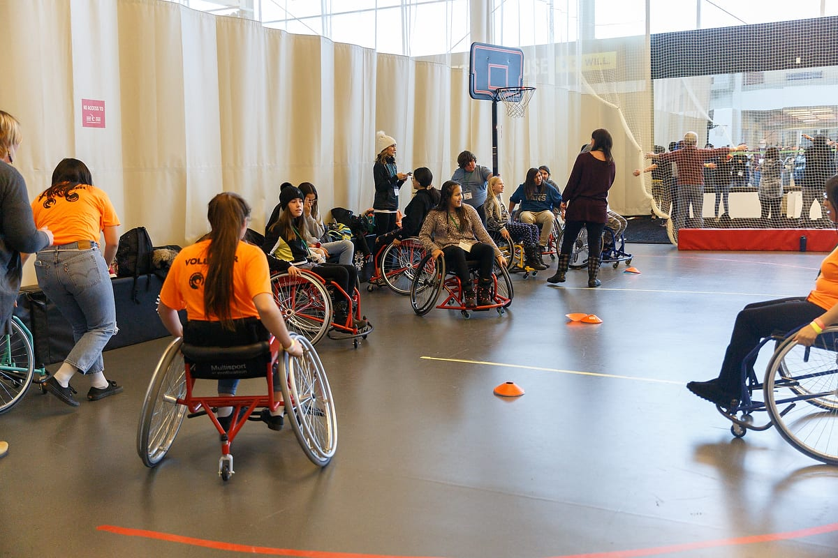 Indigenous students learn to play wheelchair basketball as part of a wellness break at the Resiliency Summit.