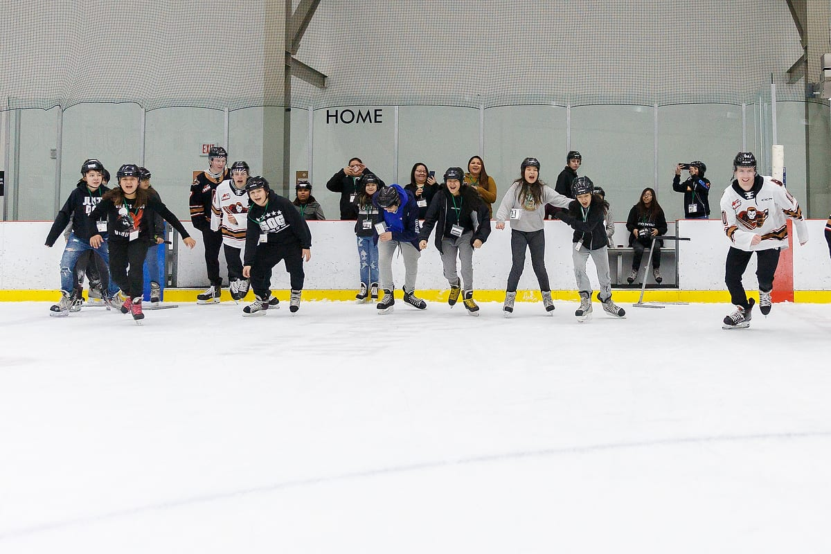 Students at the Resiliency Summit skate with players from the Calgary Hitmen during a wellness break.