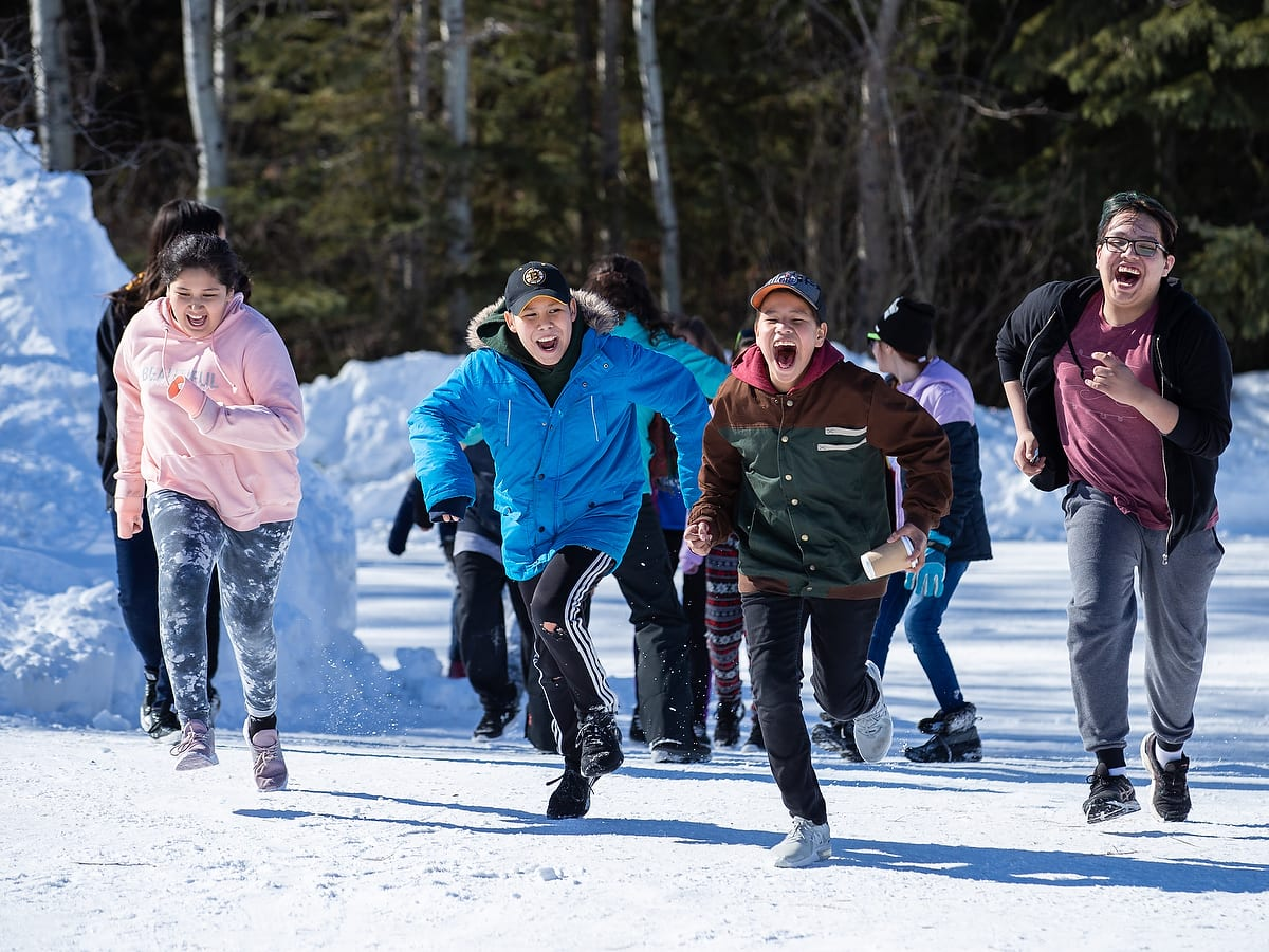 Students run outdoors in a Run and Scream activity.