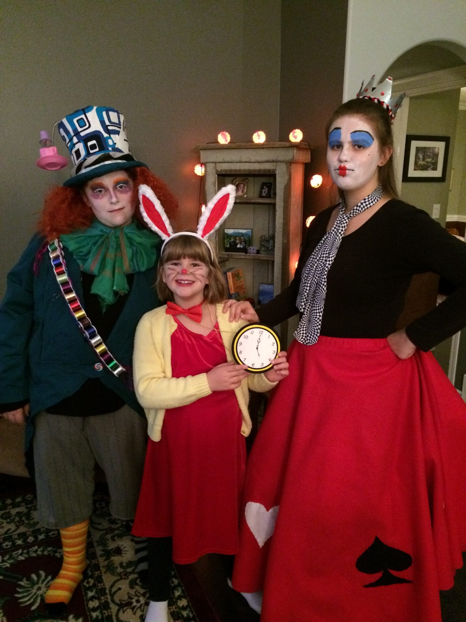 Tracey's three children dressed up in an Alice in Wonderland theme for one Halloween.