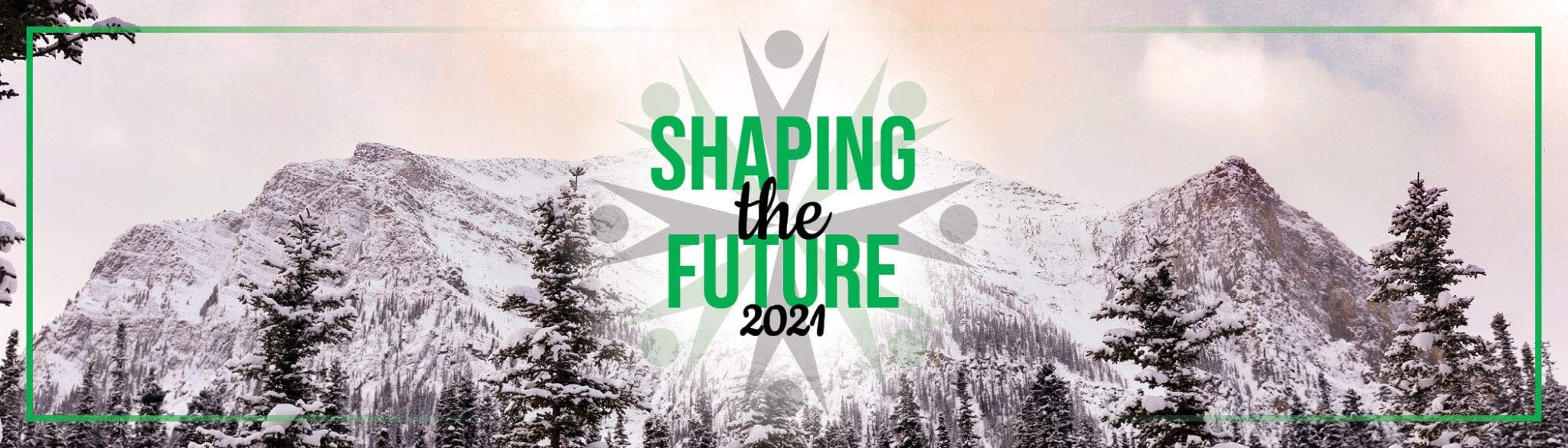 Shaping the Future 2021 logo on mountain with colourful sky.