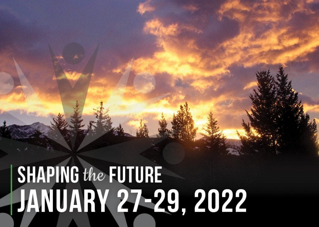 Silhouette of trees with an orange and purple cloudy sunset in the background. White text against the black trees sext says Shaping the Future / January 27-29, 2022