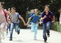 School children pupils running outside.